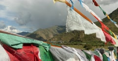 4k flying prayer flag with mountain,tibet. Stock Footage