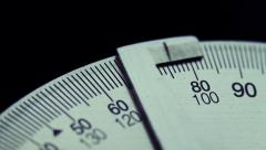 Metal protractor measure angles. Close up Stock Footage