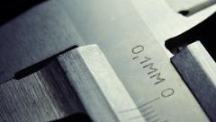 Callipers on black background. Close up Stock Footage