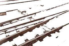 Railroad tracks in winter with snow Stock Photos