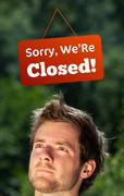 Young persons head looking at closed and open signs Stock Photos