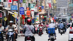 People and Traffic on Busy Street in Pham Ngu Lao - Ho Chi Minh City, Vietnam Stock Footage