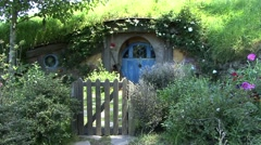 Hobbit house with blue door Stock Footage