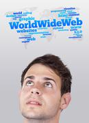 Young head looking at internet type of icons - stock photo