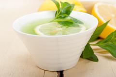 Mint infusion tea tisane with lemon Stock Photos
