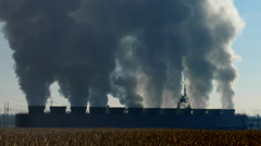 Industrial Cooling Towers Spewing Vapors into Atmosphere, Seamless Loop Stock Footage
