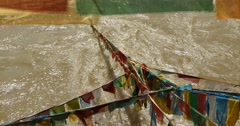 4k prayer flag on lhasa river,tibet. Stock Footage
