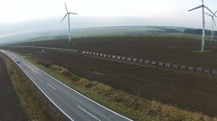 Low aerial view of wind turbine power plants - stock footage