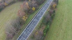 Low aerial flyover view of a country road Stock Footage