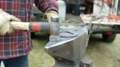Blacksmith forging a horse shoe Stock Footage