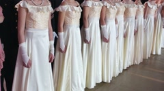 The girls dressed in same white dresses on Cadet Ball Stock Footage