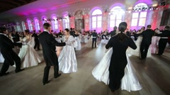 Pairs are dancing Waltz on Kremlin Cadet Ball at Manege. Stock Footage