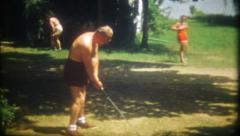 1492 - grandpa practices his golf swing - vintage film home movie Stock Footage