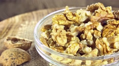 Rotating walnut seeds (not loopable) Stock Footage
