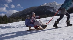 Stock Video Footage of Happy Kids Roar With Excitement When Being Pulled On Sledge