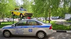 Russias police cars are next to pedestal with an militia car Stock Footage