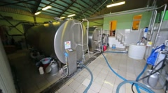 Workshop in the dairy farm with chrome tanks for milk. Stock Footage