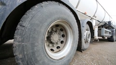 The milky truck with big wheels is getting upper in dairy farm. Stock Footage