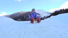 Cute Kids Toboggan Down The Snow Covered Hill On Sledge Stock Footage