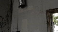 Stock Video Footage of through doorway of old rundown building