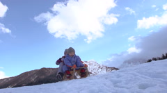 Happy Kids Toboggan Down The Snow Covered Hill On Sledge - stock footage