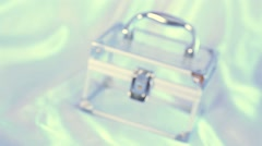Transparent glass cosmetic bag enters focus and then leaves it. Stock Footage