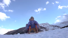 Slow-Mo: Cute Siblings Enjoy Their Winter Holidays Tobogganing Downhill Stock Footage