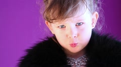 Closeup angry little girl with grey eyes in black fur cape. Stock Footage