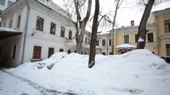 Panorama of small courtyard with snowbanks and parked cars. Stock Footage