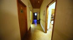 Long narrow corridor in office building with doors on both walls. Stock Footage