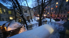 View of courtyard with bare tree trunks in snowbanks Stock Footage