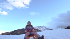 Little Girl Roars With Excitement While Sledging Down Snowy Hill Stock Footage