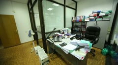 Working place - table, equipment, armchair in office - stock footage