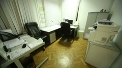 Room with two working places and office equipment. Stock Footage