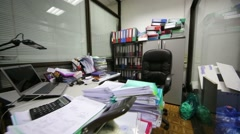 Working place in office, table is filled up with documents. Stock Footage