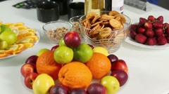 Dishes full of fruits, vases with cookies and nuts,  drinks Stock Footage