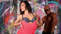 Woman dance on foreground and bald muscular man behind her. Stock Footage
