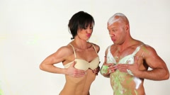 Bald man and slim woman fool around comparing their breasts. Stock Footage