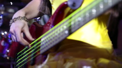 Female musician plays electric guitar Stock Footage