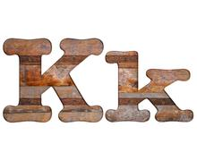letter k wooden and rusty metal. - stock illustration