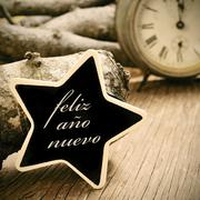 Feliz ano nuevo, happy new year in spanish, in a star-shaped chalkboard, in s Stock Photos