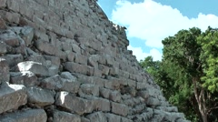 Mexico Yucatan Central America Chichen Itza 006 pan along stone wall Stock Footage