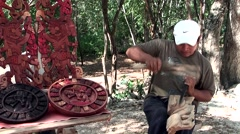 Stock Video Footage of Mexico Yucatan Central America Chichen Itza 023 Native American is carving wood