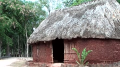 Mexico Yucatan Central America Chichen Itza 027 clay hut with thatched roof Stock Footage