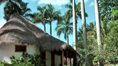 Mexico Yucatan Central America Chichen Itza 028 hut with thatched roof Stock Footage