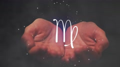 Horoscope Virgo sign. Female hands holding zodiac sign for Virgo. - stock footage