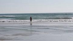 Surfer with Board walking toward Ocean Waves 2 Stock Footage