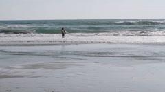 Surfer with Board walking toward Ocean Waves Stock Footage