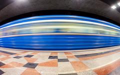 Blue subway train in motion at the underground station. wide angle Kuvituskuvat