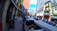 People walk along the 25 March (25 de Marco) in Sao Paulo, Brazil Stock Footage